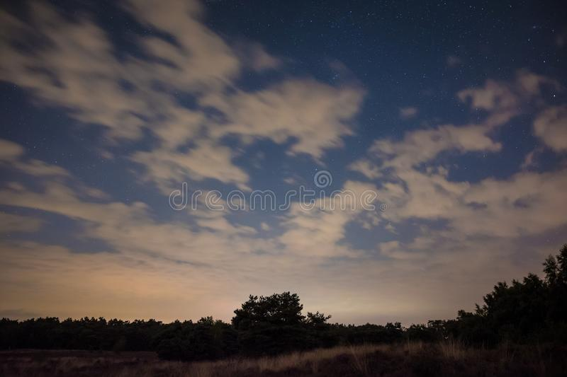 Cloudy nightsky in Maasduinen national park in the Netherlands royalty free stock photos