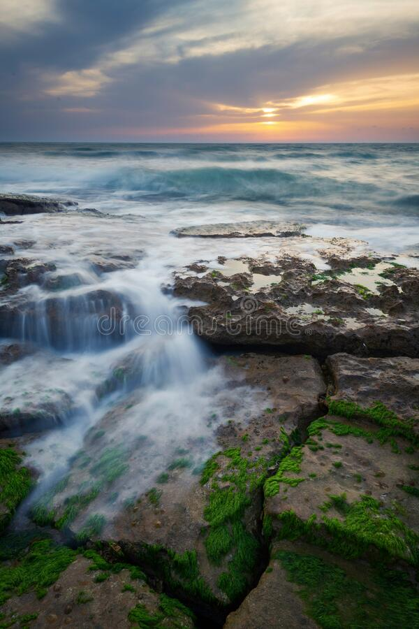 Cloudy serene sunset seascape stock photography