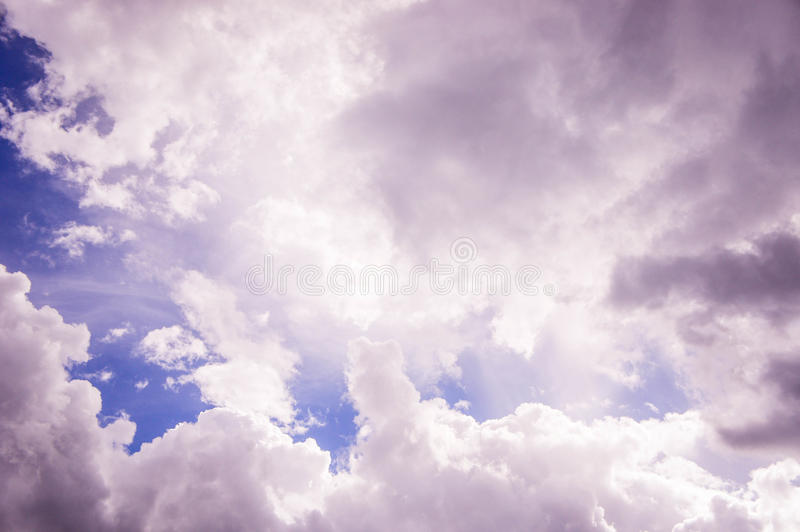 Cloudy skies. Dark sky With the light through the clouds stock photos
