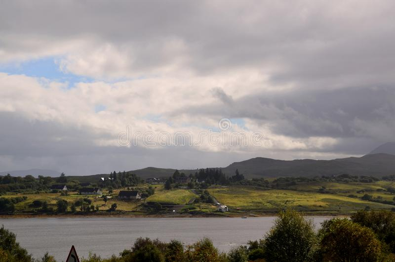 Cloudy skies in Isle of Skye with beautiful scenic landscape royalty free stock photos