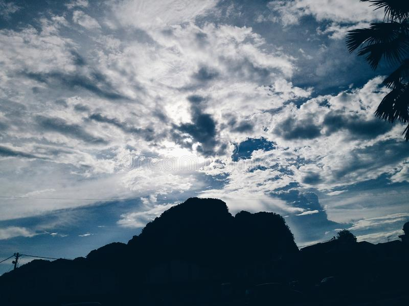 Cloudy skies nature. Nature cloudy skies with mountain royalty free stock photography