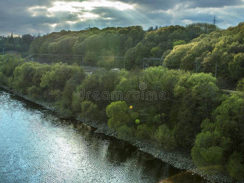 Beautiful summer landscape, view of the cloudy sky, river and trees. royalty free stock photos