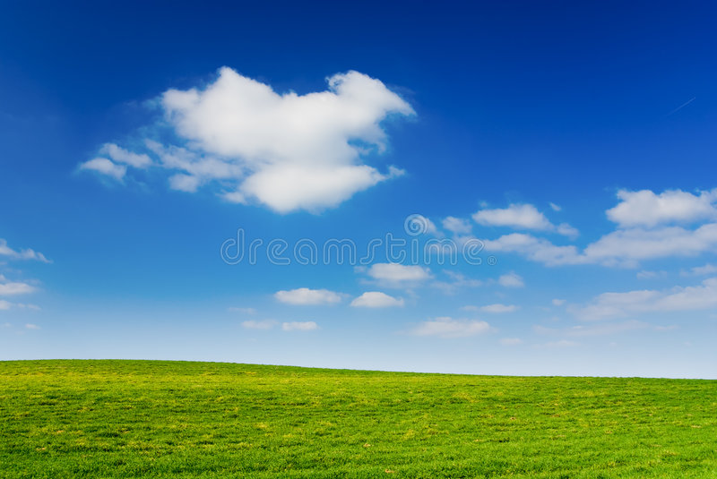 Cloudy sky. Blue cloudy sky, green grass (background, wallpaper royalty free stock photos