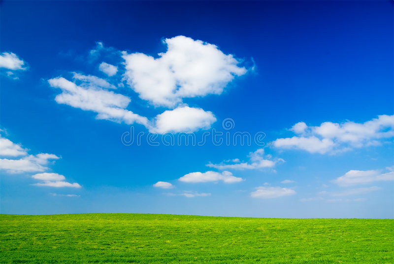 Cloudy sky. Blue cloudy sky, green grass (background, wallpaper stock images