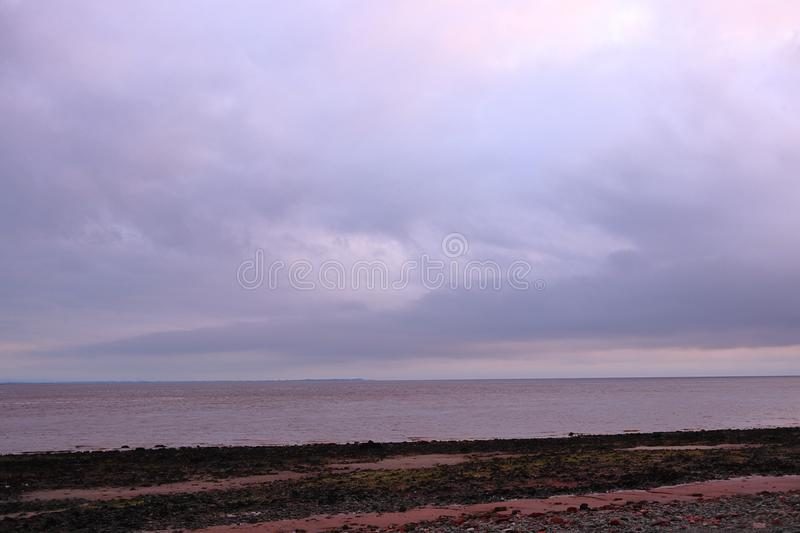 Cloudy sky above the firth stock photography