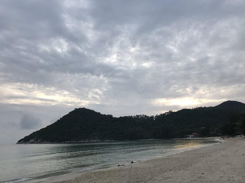 Cloudy sky beach royalty free stock photography