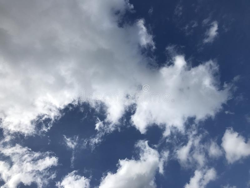 Cloudy sky on a bright day royalty free stock photos