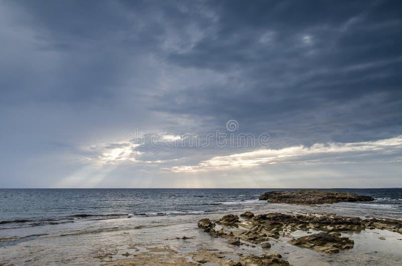 Download Cloudy Sky With Coast, Is Aruttas, Sardinia Stock Photo - Image: 34497550