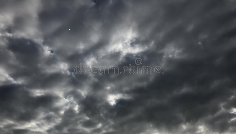 Cloudy sky on a dark day stock images