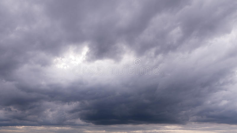 Cloudy sky full of deep grey clouds. Storm is coming. royalty free stock photo