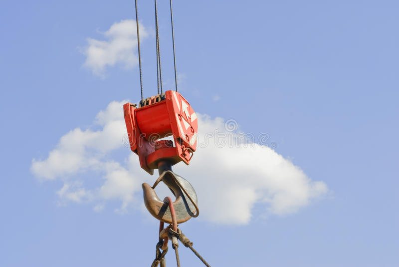 Cloudy sky and hook crane royalty free stock images