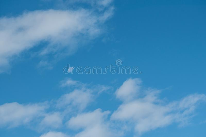 cloudy sky with the moon royalty free stock photography