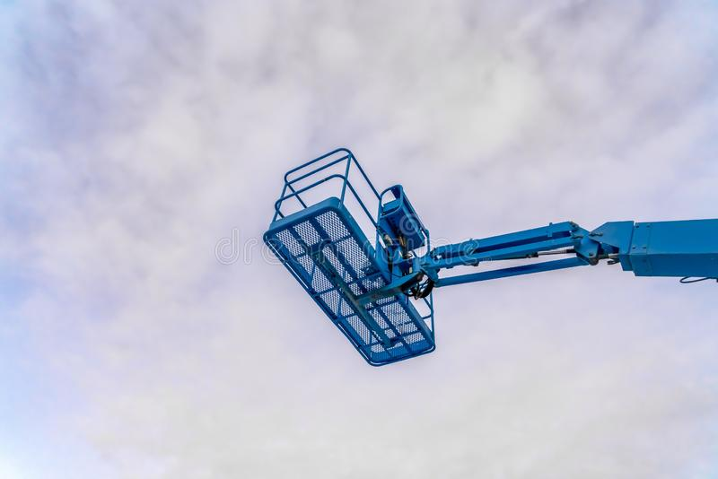 Cloudy sky over a boom lift in Eagle Mountain Utah. A vast cloudy sky in Eagle Mountain, Utah over an empty boom lift. The mechanical device is used by workers royalty free stock images