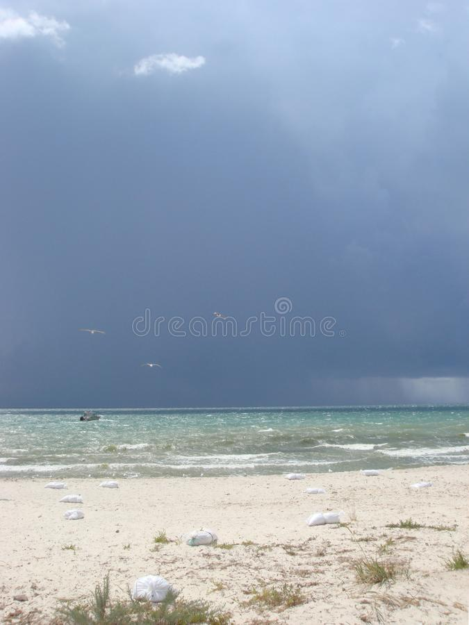 Cloudy sky over the sea. Storm clouds forming over clear sea stock images