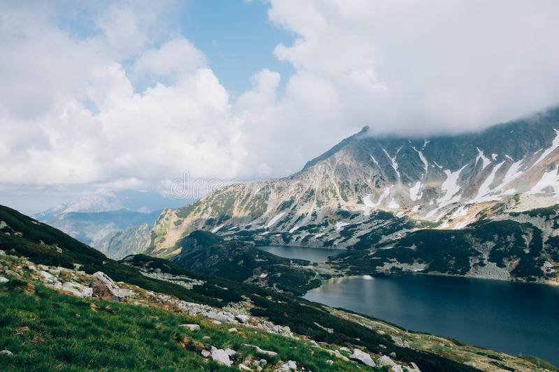 Cloudy sky over Valley of Five Lakes Tatra National Park, Poland Dolina Pieciu Stawow Polskich stock images