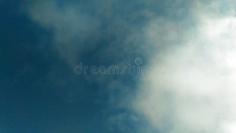 Cloudy sky. Section of blue cloudy sky stock photography