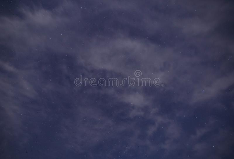 Cloudy sky with stars at night stock photos