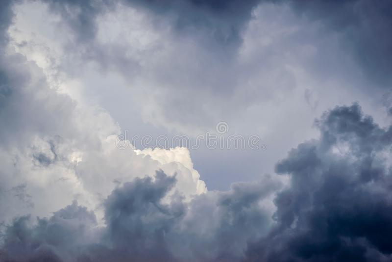A cloudy sky with storm clouds. Cloudy sky with dark gray storm clouds and light in the middle royalty free stock photos
