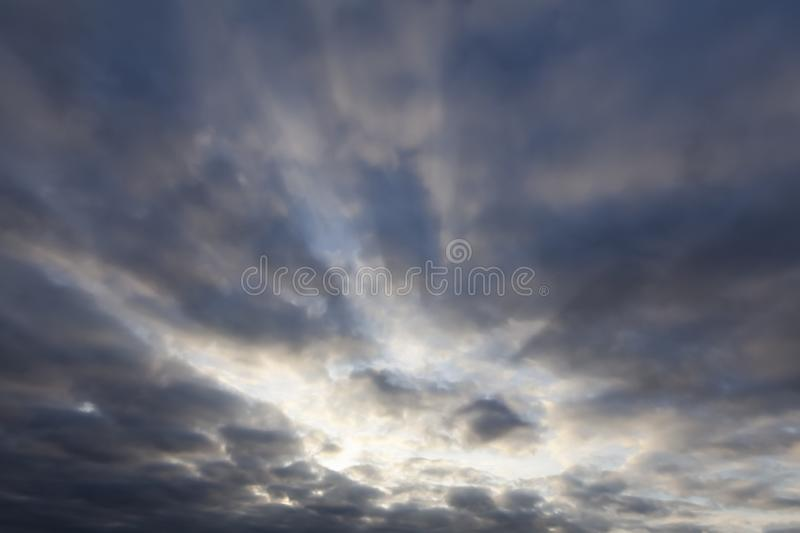 Cloudy sky with sun breaking 0198. Cloudy sky with sun breaking through. Cloudscape nature background royalty free stock image