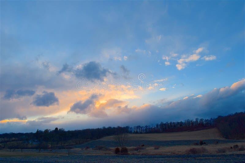 Cloudy sky at sunset stock photos