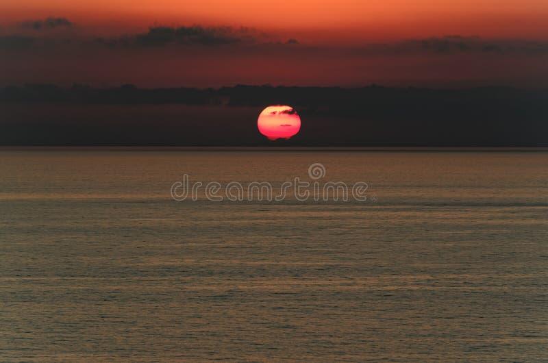 Cloudy sky at sunset above the tyrrhenian sea. View from Riaci beach near Tropea, Italy stock photography