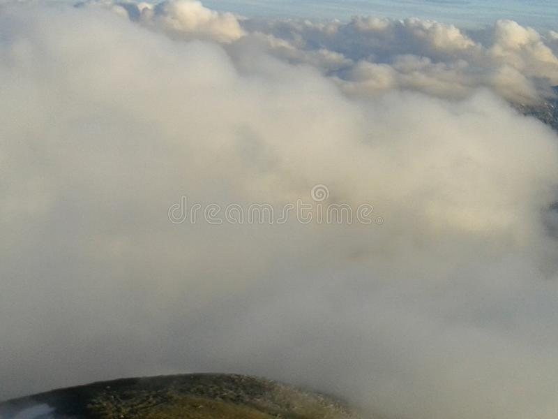 Cloudy sky at sunset over mountain top. Clouds over mountain royalty free stock image
