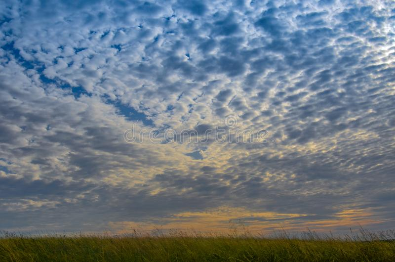 Cloudy sky and sunset. Beautiful sunset in the meadow stock photos