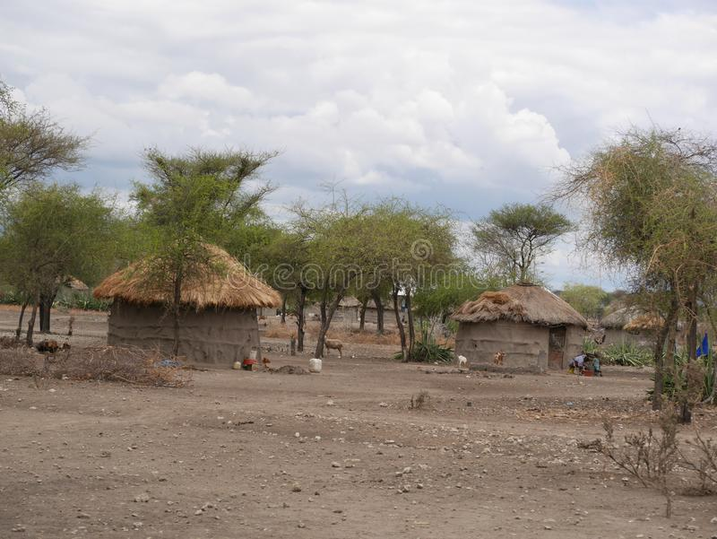The village of the Masses in Tanzania. Cloudy sky in Tanzania, Africa, to meet adventures, safaris, Tarangiri, Ngorongoro,gray earth, the village of the Masses stock images