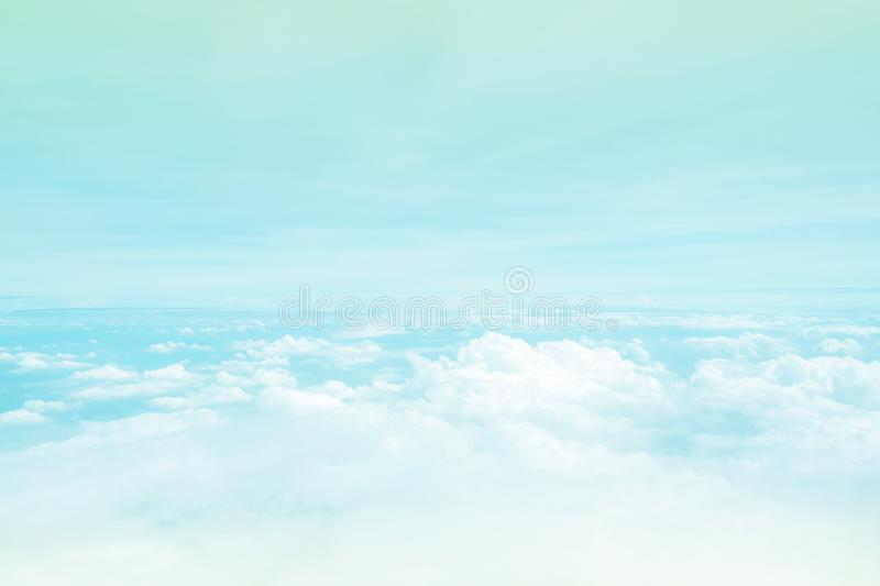 Cloudy sky from window airplane view. Nature and abstract backgr. Ound. Fluffy cloud like space on heaven. With color filter, pastel tone royalty free stock photos