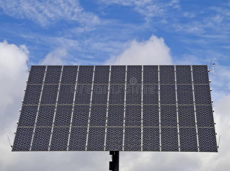 Cloudy Solar Power. Solar Power Station at a solar park in Germany in front of a cloudy sky royalty free stock photos