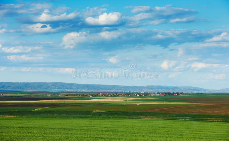 Cloudy spring landscape stock images