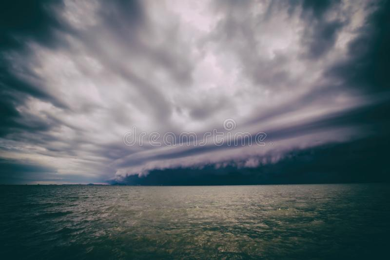 Cloudy storm in the sea before the rain. tornado storms cloud above the sea. Monsoon season. Hurricane Florence royalty free stock images