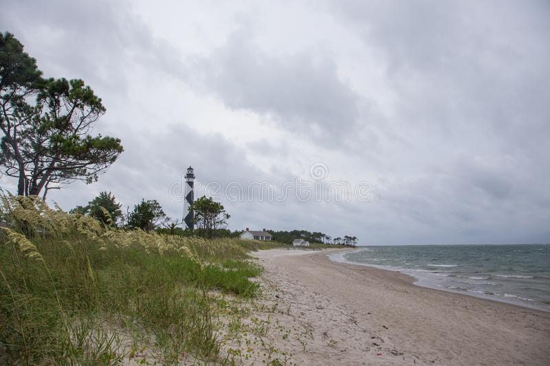 Cloudy Stormy Skies over Cape Lookout Light house. Cape Lookout National Seashore, North Carolina, United States - grey cloudy skies frame the beach and royalty free stock photography