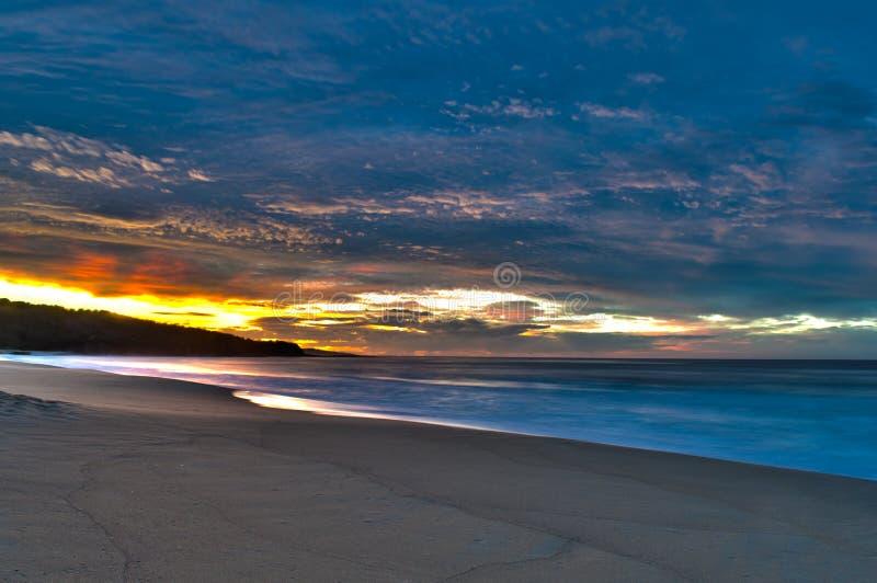 Cloudy Sunrise Over Beach stock image