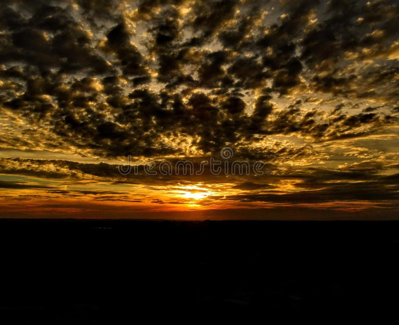 Cloudy sunset in Bavaria stock images