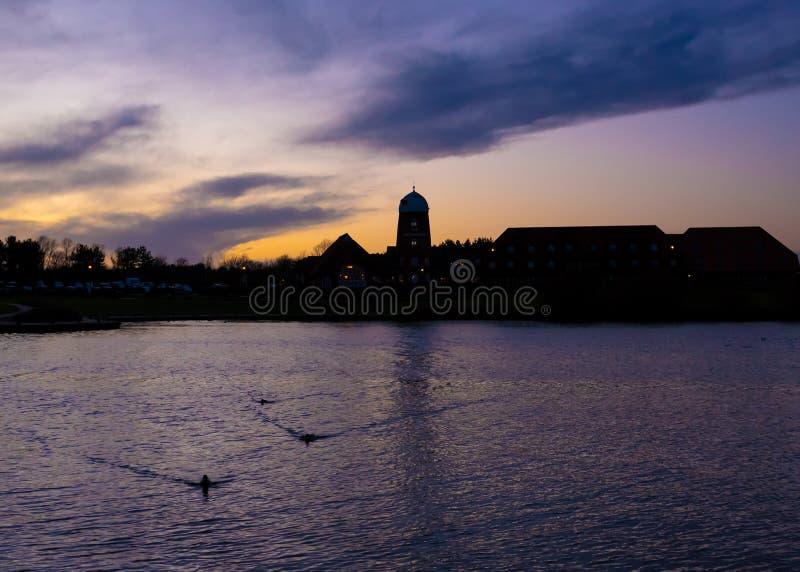 Cloudy sunset at Caldecotte Lake, Milton Keynes. Cloudy sunset at The Caldecotte - Pub & Grill, Milton Keynes, United Kingdom royalty free stock photos