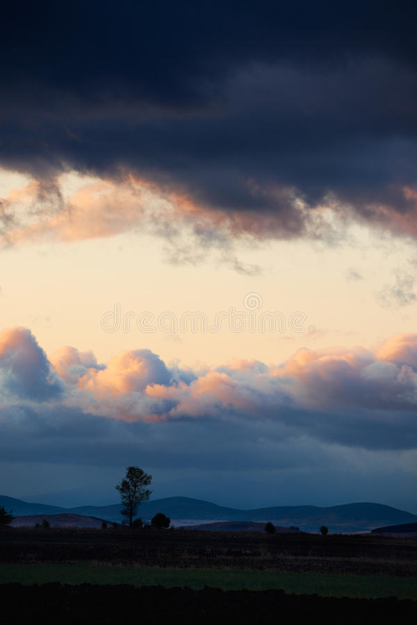 Cloudy sunset landscape royalty free stock photo