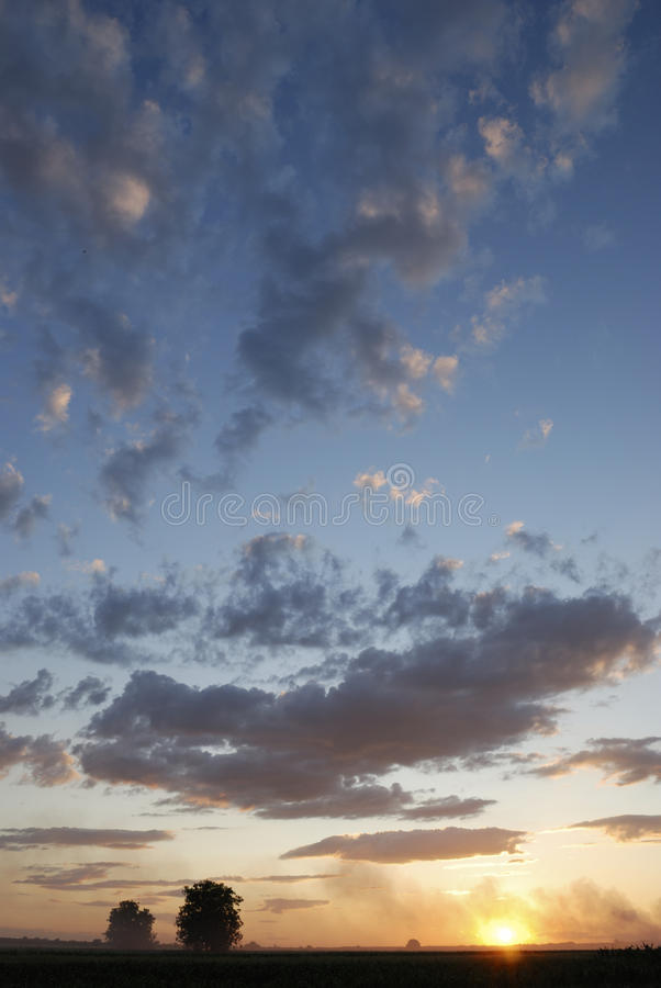 Download Cloudy Sunset Over Countryside Field Stock Photo - Image: 26587008
