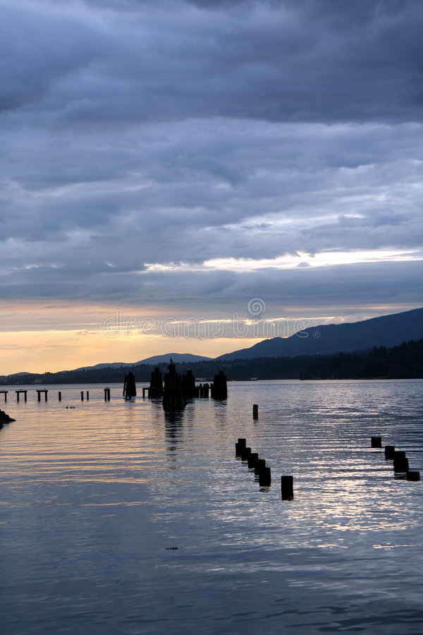 Cloudy sunset seascape stock photos