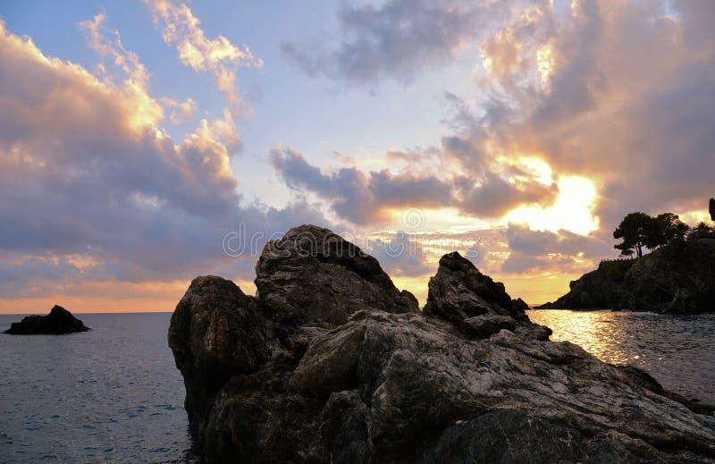 Cloudy warm sunset on desert beach in Levanto, liguria Italy royalty free stock photo