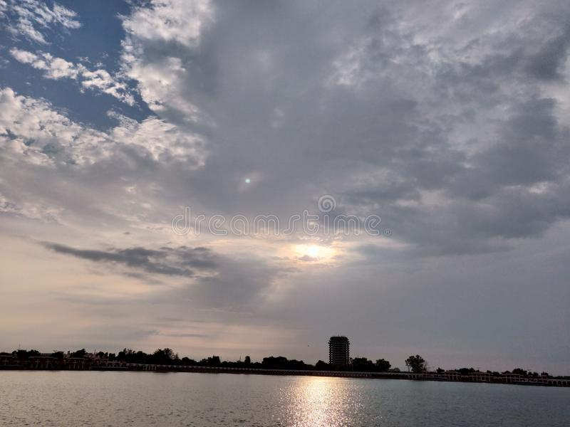 The Cloudy Weather. Upon artificial lake stock images