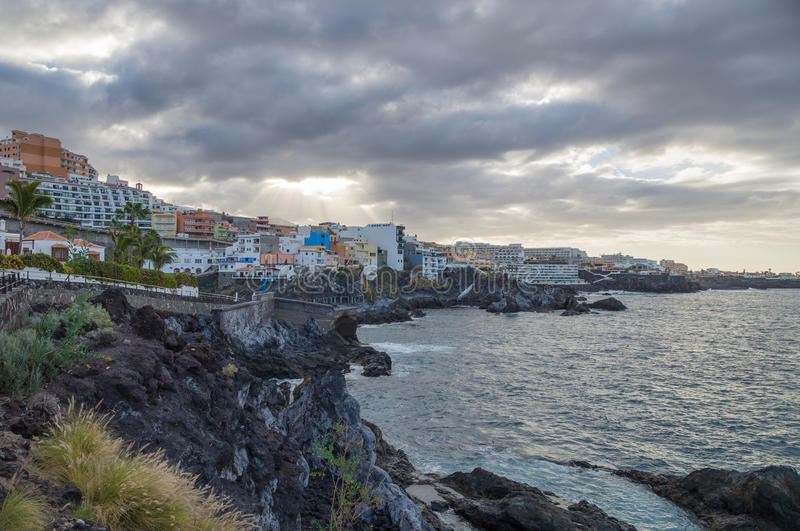 Cloudy weather in coastal resort town Puerto de Santiago. Tenerife, Canary Islands, Spain royalty free stock image