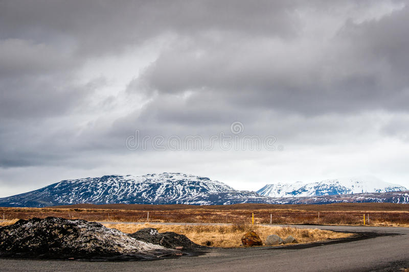 Cloudy weather by a road. In dramatic landscape royalty free stock images