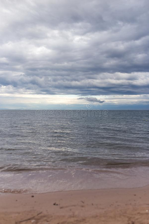 Cloudy weather on the sea as background stock photos