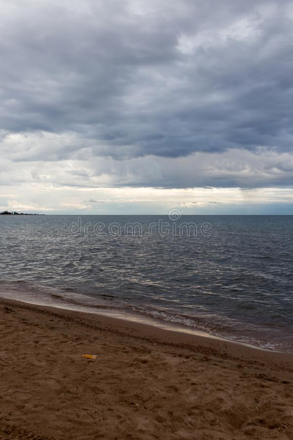 Cloudy weather on the sea as background royalty free stock photos