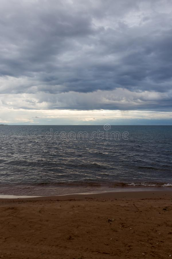 Cloudy weather on the sea as background stock image