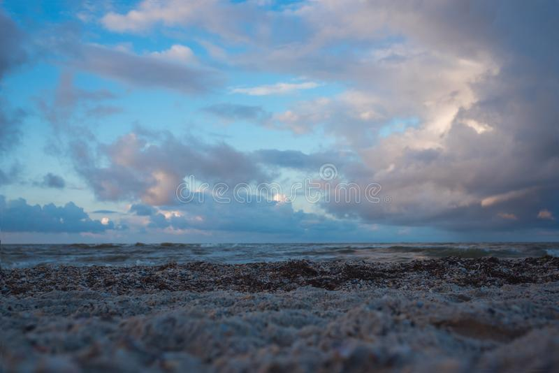 Cloudy weather at the sea with beautiful clouds. Cloudy weather at the sea with dark clouds royalty free stock image