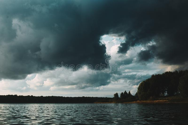 Cloudy and windy weather on the lake royalty free stock images