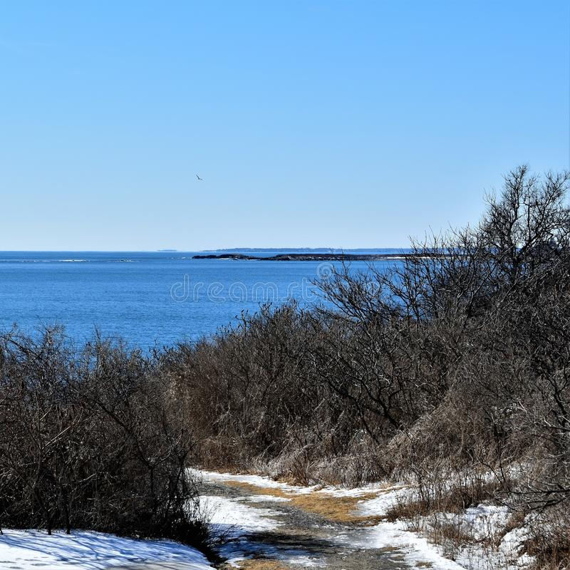 Two Lights State Park and surrounding ocean view on Cape Elizabeth, Cumberland County, Maine, ME, United States, US, New England. Cloudy winter landscape view of royalty free stock photo