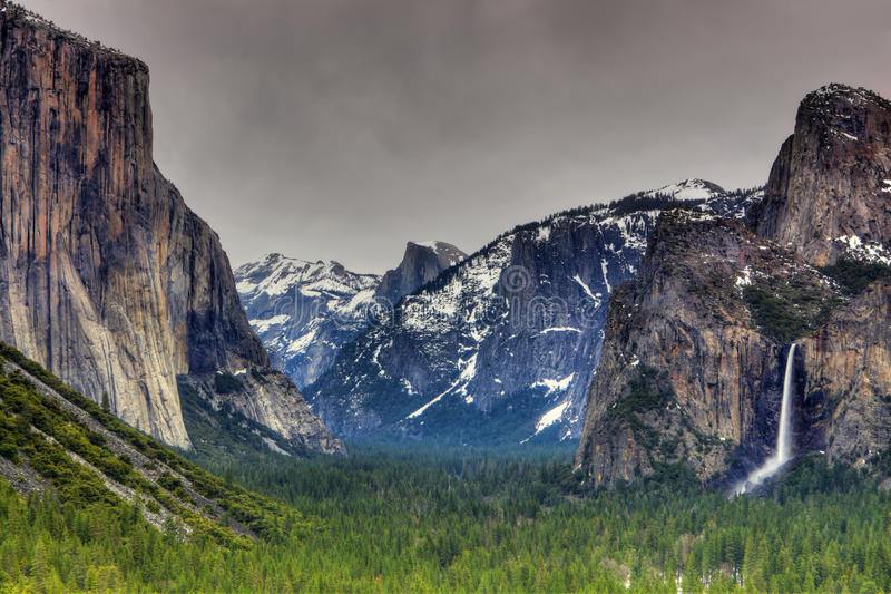 Cloudy Yosemite Valley. With a view of El Capitan, half dome, and bridal veil falls stock images